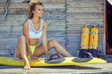 Surfing girl posing in the beach with surfboard - 211912020