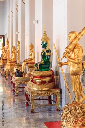 Plexiglas Bangkok Emerald Buddha statue in Buddhist temple.