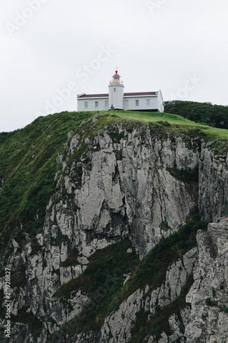 Fotobehang Vuurtoren Lighthouse on the cliff