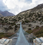 Metal suspension bridge in the Himalayas, Nepal. - 211932248