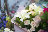 the White lilies and colorful roses in kraft paper as a birthday present