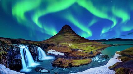 Northern Light, Aurora borealis at Kirkjufell in Iceland. Kirkjufell mountains in winter. © tawatchai1990