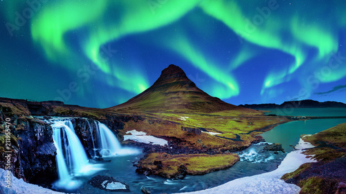 Northern Light, Aurora borealis at Kirkjufell in Iceland. Kirkjufell mountains in winter. - 211955470