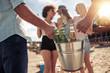 Leinwanddruck Bild - Young friends enjoying a beach party