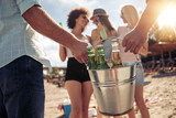 Young friends enjoying a beach party