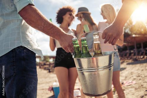 Leinwanddruck Bild Young friends enjoying a beach party
