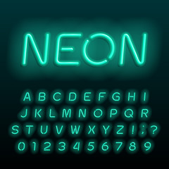 Neon lamp alphabet font. Neon color oblique letters, numbers and symbols. Stock vector typeface for any typography design. © epifantsev