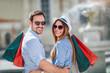 Leinwanddruck Bild - Beautiful couple enjoy shopping together, young couple holding shopping bags