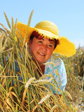 Overweight woman enjoying life during summer vacations. Happy obese farmer relaxing on wheat field. Healthy lifestyle concept. - 211976226