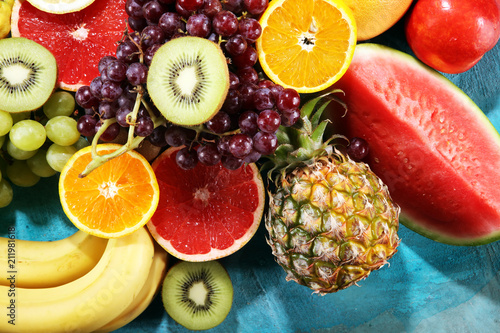Fresh organic fruits background. Healthy eating concept. - 211981618