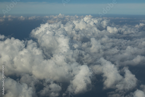 Beautiful white clouds forming and moving in blue sky  - 211993045