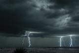Lightning storm over field in Oklahoma - 211999834