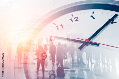 Leinwandbild Motiv Business times concept people walking overlay with time clock