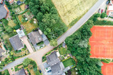 Vertical aerial view of a suburban settlement in Germany with detached houses, close neighbourhood and gardens in front of the houses. - 212041816
