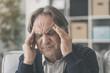 Old man suffering from headache