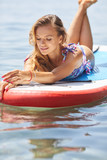 SUP Stand up paddle board woman paddle boarding on lake standing happy on paddleboard on blue water. - 212050009