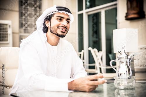 Fotobehang Abu Dhabi arabic business men spending time in Dubai