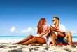 Summer trip on beach. Two lovers and sea landscape with blue sky. Free space for your text.
