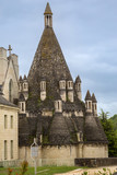 The famous kitchen building at the Royal Abbey of our Lady of Fontevraud, a former monastry in the Loire Valley, France - 212060419