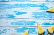 Leinwanddruck Bild - Pineapples on ice cream sticks on wooden background. Minimal summer concept.