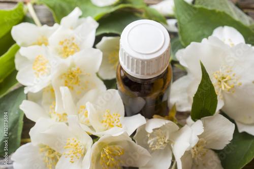 Oil of jasmine. Aromatherapy with jasmine oil. Jasmine flowers © Elenglush