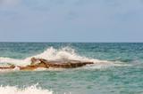 crushing waves with big rocks - 212076232