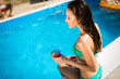 Sexy woman enjoying summer in pool