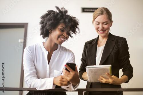 Female co-workers talking.