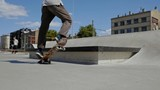 Young skater doing tricks outdoors. Slowmotion video 150fps - 212098060