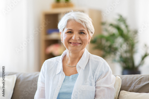 Leinwanddruck Bild emotion, age and people concept - portrait of happy senior woman laughing