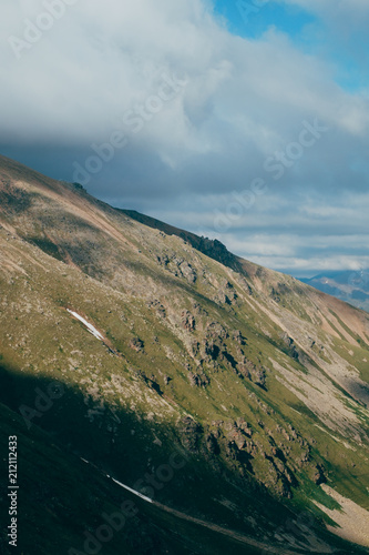 Fotobehang Zomer highlands mountain landscape and mainly cloudy gloomy sky