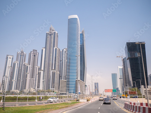 Modern buildings and street in Dubai on a clear day