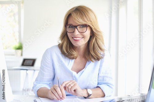 Fototapeta Successful businesswoman working at modern office