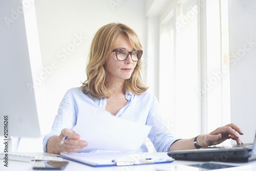 Wall mural Professional woman working at the office