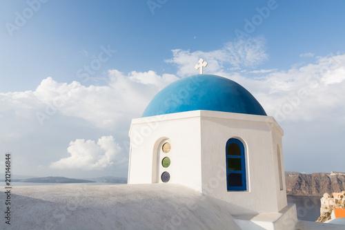 Fotobehang Santorini Details of a traditional Greek orthodox blue dome church, Santorini, Greece