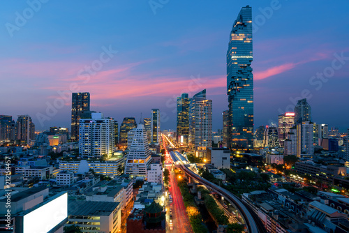 Bangkok Transportation at Dusk with Modern Business Building from top view in Bangkok, Thailand.