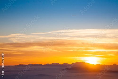 Fotobehang Meloen Mountain silhouette at sundown