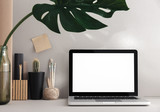 Stylish desk with laptop mock up. Minimal workspace desk of designer. - 212159693