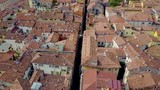 Aerial flight pan up over old Italian street - 212168260
