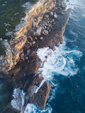 Aerial view of rock cliff and the ocean water. - 212175095
