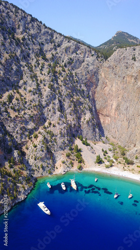 Fotobehang Bleke violet Aerial birds eye view photo taken by drone of famous tropical rocky beach of Agios Georgios with yachts docked, Symi island, Dodecanese, Greece