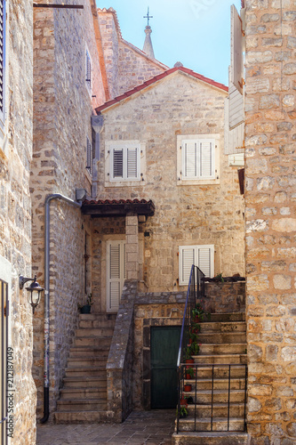 Fotobehang Smalle straatjes Old historical buildings in the narrow street at ancient city Budva, Montenegro