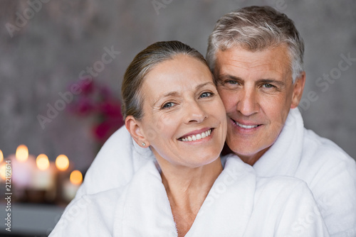 Leinwanddruck Bild Mature couple in bathrobe at spa