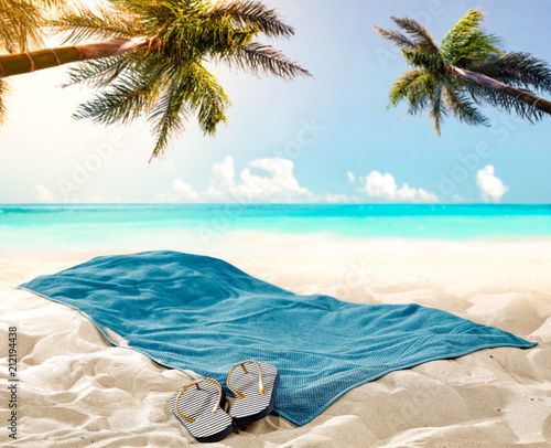 Leinwanddruck Bild towel background on beach and free space for your decoration.