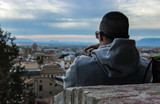 young man looking the city of granada