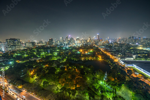 Plexiglas Bangkok Bangkok skyline at night with Lumphini Park in the foreground
