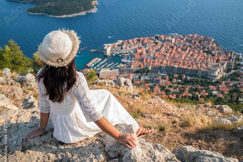 Leinwanddruck Bild Traveller looking at view of Dubrovnik, Croatia