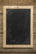 Blank chalkboard on rustic wooden background