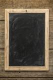 Blank chalkboard on rustic wooden background - 212215081