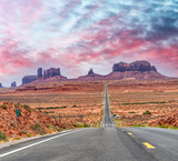Historic US Route 163 running through famous Monument Valley on a beautiful sunny day with blue sky in summer, Utah, USA - 212222641